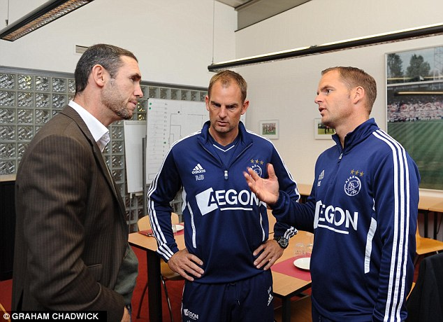 Chatter: Ronald de Boer (right) has talked up his brother's ability if he is to land the Spurs job this summer, including in a recent interview with Sportsmail's Martin Keown