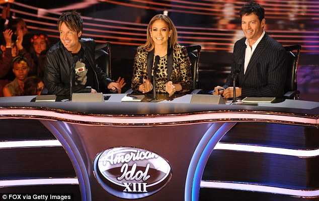 She knows what she's talking about: Jennifer Lopez, pictured centre, serving as judge on the thirteenth season of American Idol