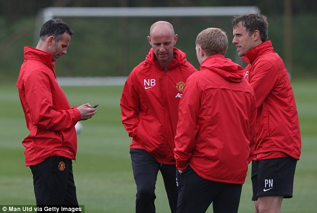 Transition: Reports suggest Giggs and his coaching staff could soon be replaced by Louis van Gaal
