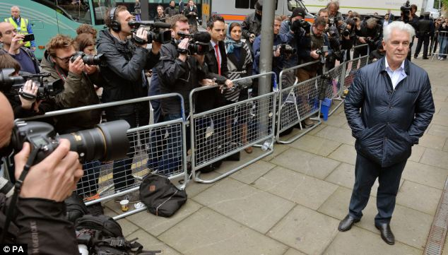 Before entering court this morning, Clifford paused for a mass of photographers and TV crews to get pictures and footage