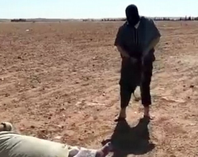 Chilling: After the man keels over another militant armed with an AK-47, who researchers believe is British, prepares to fire more shots