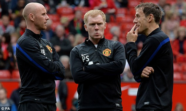 Old pals' act: Paul Scholes (centre) was also brought back into the fold at Old Trafford alongside former teammates Nicky Butt (left) and Phil Neville (right)