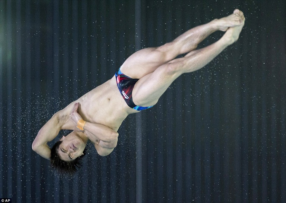 Flipping brilliant: China's Huo Liang competes in the men's 10-metre platform preliminary event at the FINA diving grand prix at the Gatineau Sports Complex in Gatineau, Quebec