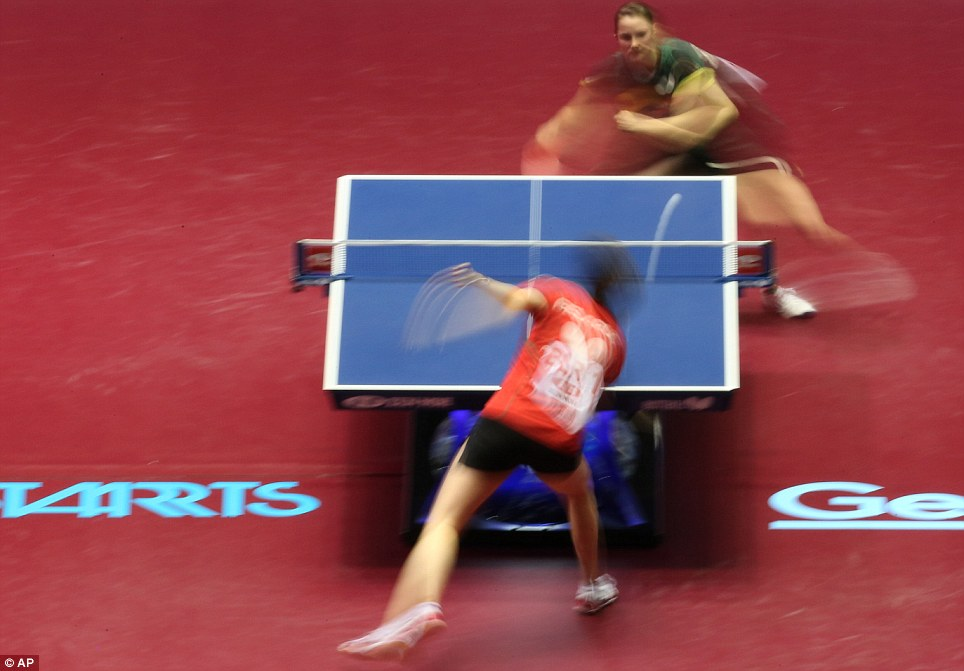 Ping and pong: Sabine Winter of Germany (top) and Voktoria Pavlovich of Belarus compete during their best eight play-off match of the World Team Table Tennis Championships in Tokyo