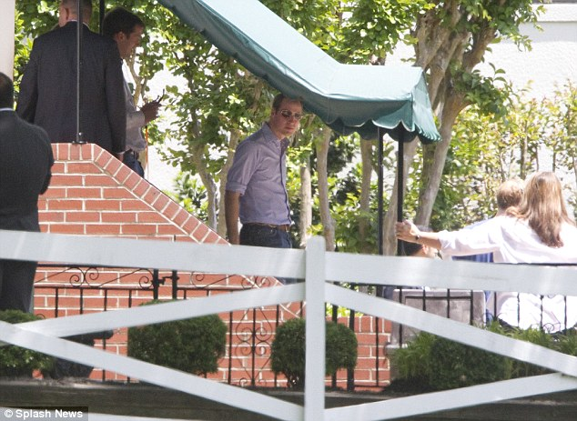 Prince William seen here walking down the stairs at the Graceland mansion, the beloved home of Elvis Presley where he died in 1977