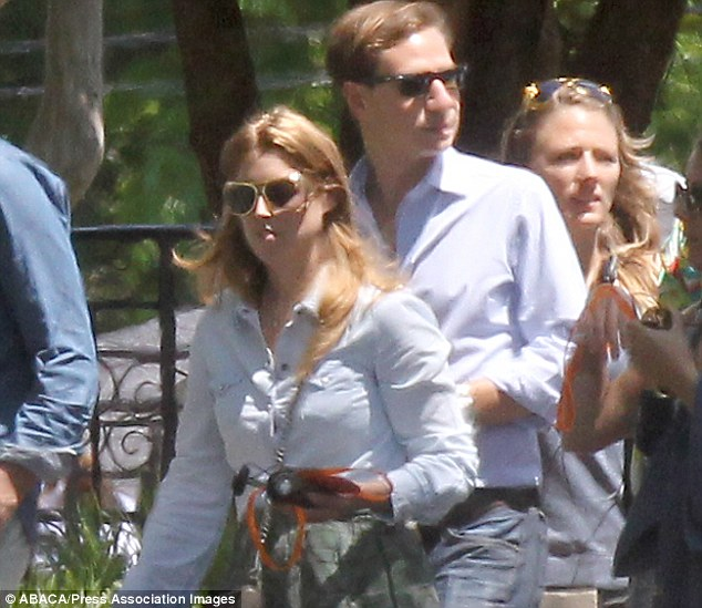 Princess Beatrice, pictured in fun Elvis sunglasses and carrying her audio guide with boyfriend Dave Clark at Graceland
