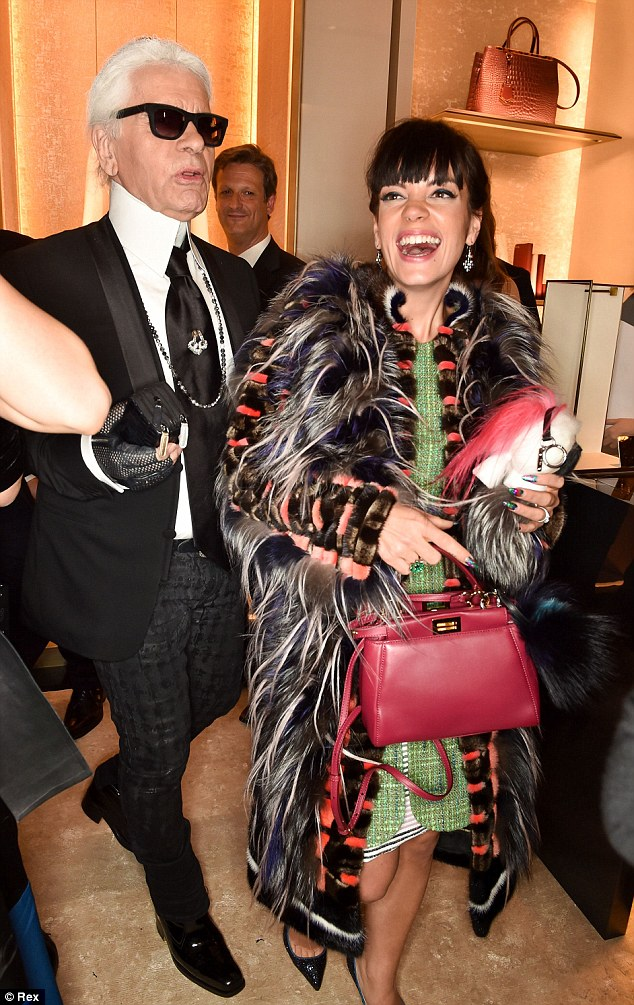 Fendi loving: The singer wore a distintive coat by the brand as she attended the store launch with designer Karl Lagerfeld (L)