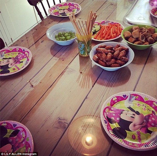 Family time: The Hard Out Here singer also posted an picture of her kitchen table which had Disney plates and party food for her to share with her daughters Ethel, two, and Marnie, 15 months, as well as her husband Sam Cooper