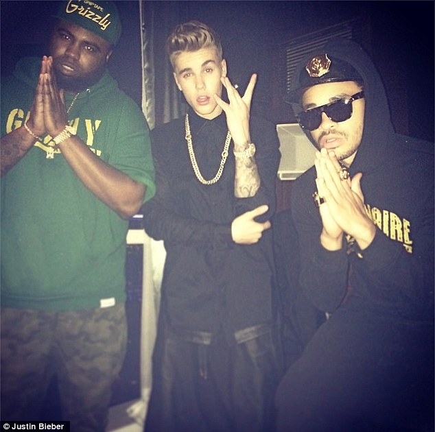 Westside repping: Justin, 21, poses with music producer Maejor Ali and rapper Blake Kelly aka Papi Gordo
