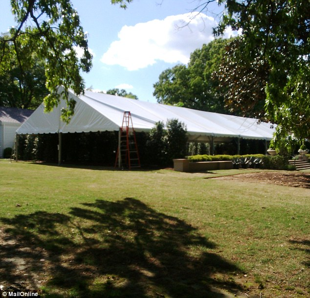 Al fresco: A large white tent, pictured earlier this week, has been erected on a lawn next to the club beside an outdoor pool