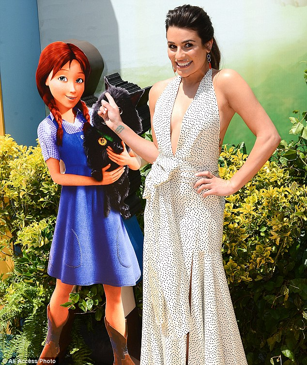 Cute! Lea posed with cut-out caricatures as she promoted her latest film in which she plays Dorothy
