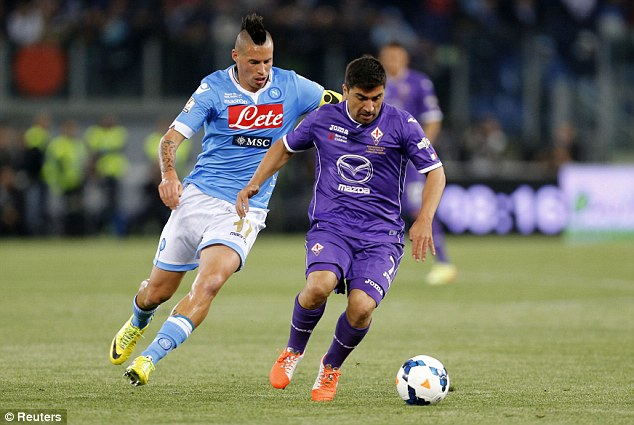 All action: Fiorentina's David Pizarro is challenged by Hamsik during the Italian Cup final