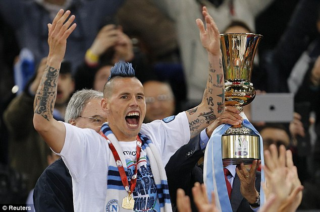 Party time: Hamsik celebrates before receiving the Italian Cup trophy after Napoli's win over Fiorentina