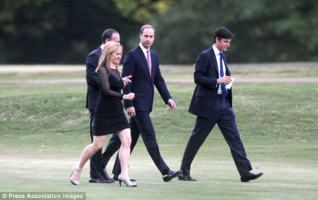 After a number of casual events, William and the group looked smart in suits as they headed for a drinks do