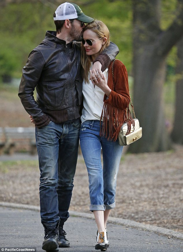 Madly in love: Kate Bosworth and Michael Polish took a romantic stroll through Central Park on Friday