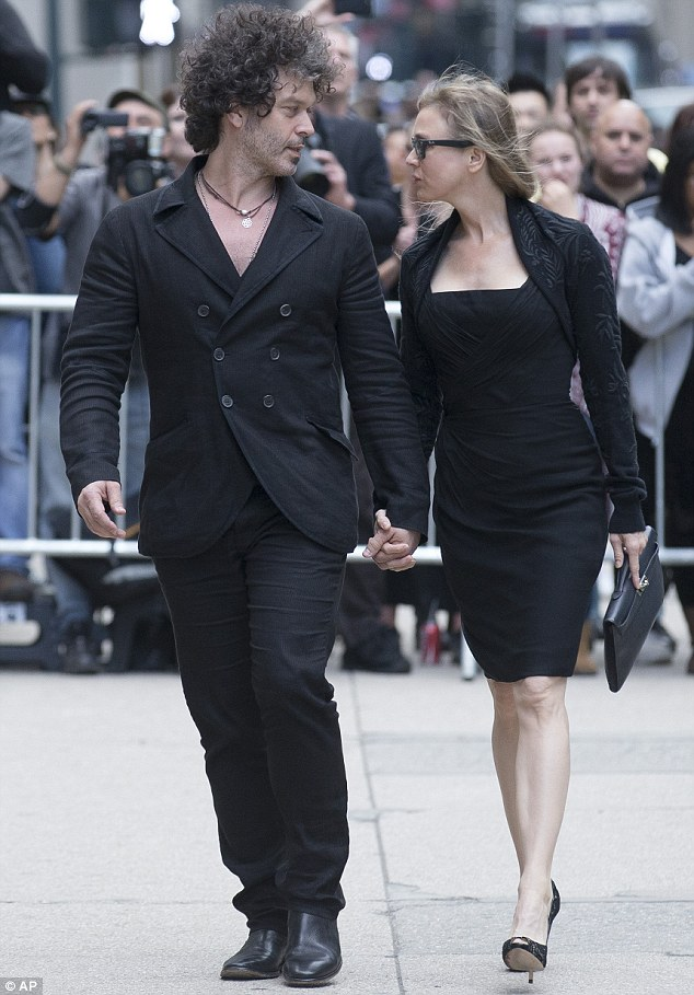 Who's who: Renee Zellweger and her boyfriend Doyle Bramhall arrive at St. Bartholomew's Church