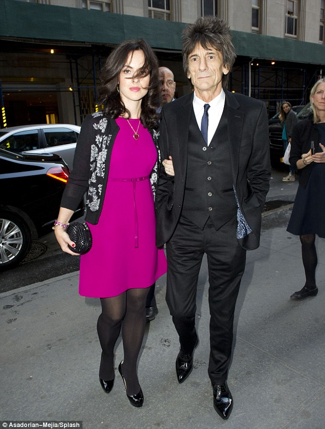 Supportive: Ronnie Wood and his wife Sally Humphries arrive to honor Mick Jagger's longtime girlfriend