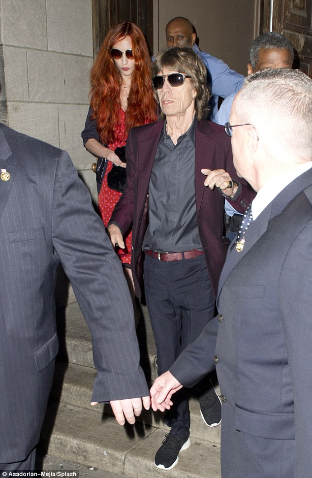 Honoring L'Wren: Mick Jagger with his daughter Elizabeth at the memorial service last night for his lover L'Wren Scott, who committed suicide in March. He sang Bob Dylan classic Just Like a Woman in her memory