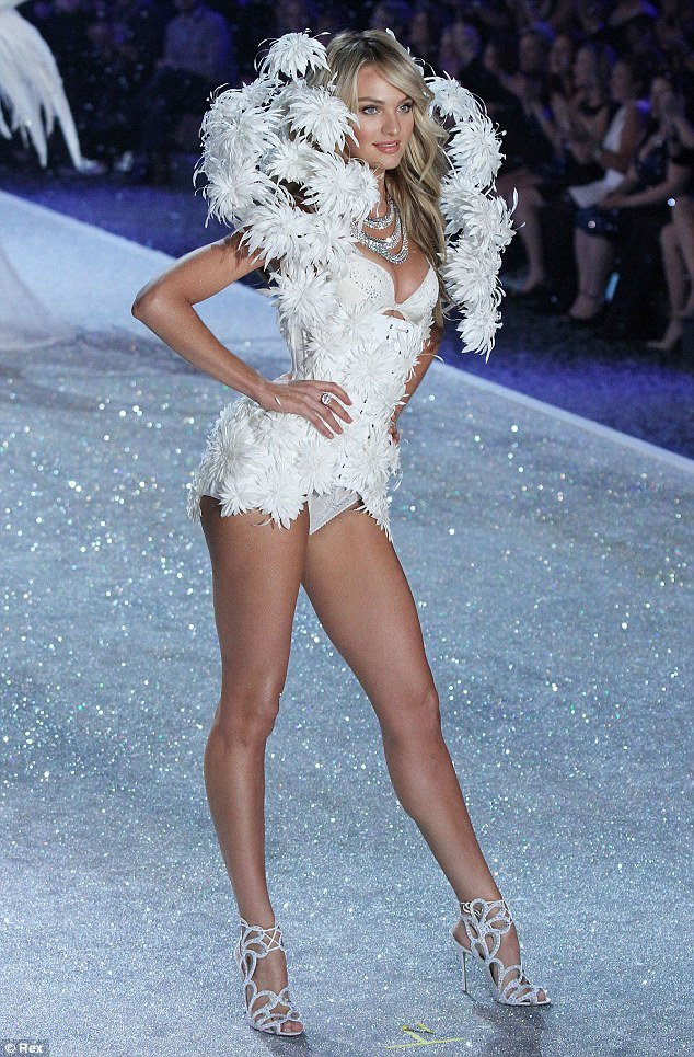 Feathered angel! Candice walks the catwalk at the Victoria's Secret Fashion Show in New York on November 13