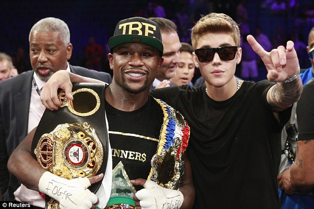 Unlikely team: Floyd Mayweather Jr (left) and Justin Bieber (right) are reportedly combining forces to purchase the Clippers