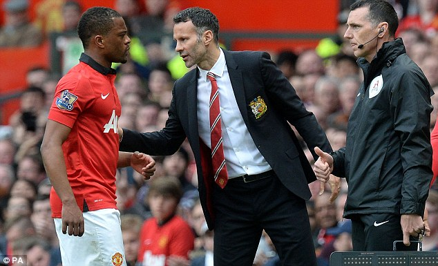 New man: Ryan Giggs has taken interim charge and Ferdinand says he's taken to the role well