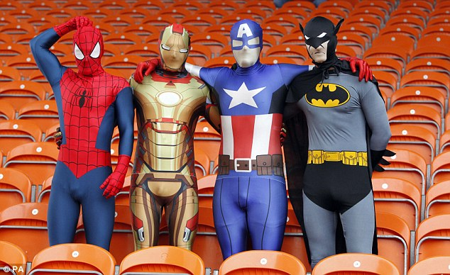 To the rescue: Charlton fans dressed as super heroes to cheer on their side at Bloomfield Road