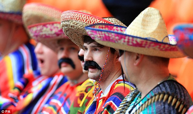 Fancy dress: Blackpool fans get into the spirit of the last day of the 2013/14 Championship season