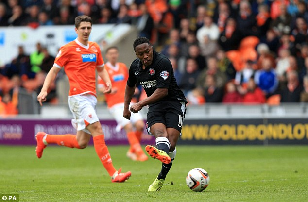 Ahead: Charlton Athletic's Callum Harriott scores the opening goal against Blackpool at Bloomfield Road