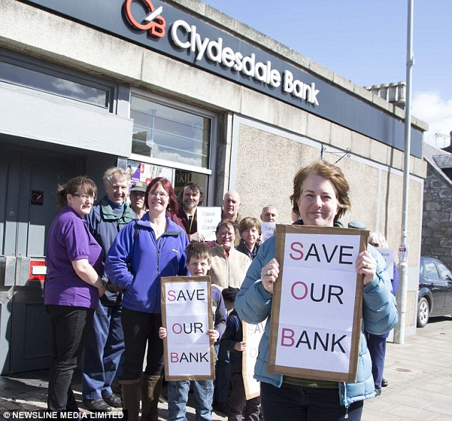 Closure fight: Gillian Young and protesters at the doomed branch and, above, the bank slogan