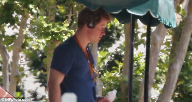 A sombre looking Prince Harry as he toured Graceland on Friday leading up to the wedding of close friend Guy Pelly