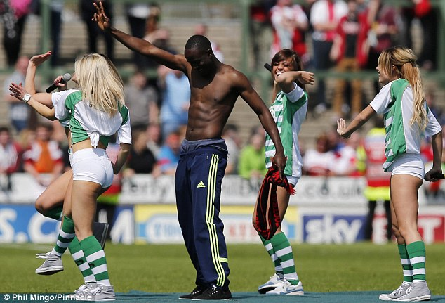 Summer shenanigans: Albert Adomah of Middlesbrough dances with the Yeovil Town girl band Viva Pitch