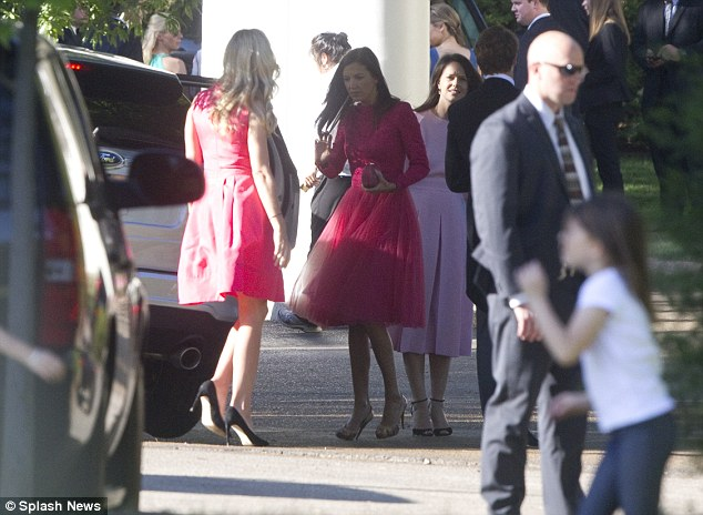 In the pink: Guests in pretty pink frocks arrive for the marriage of Guy Pelly and Lizzy Wilson