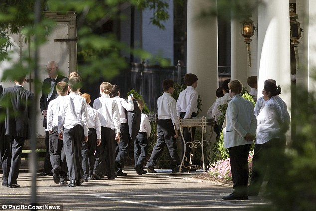 Serenade: A choir of young boys arrived and were heard practicing 'Amazing Grace' outside the venue