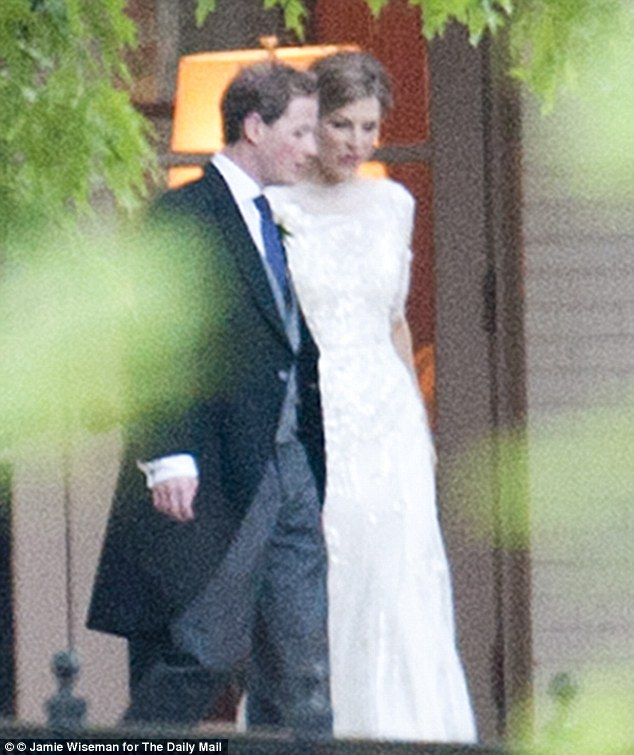 The happy couple: The new Mr and Mrs Pelly emerge after their wedding ceremony