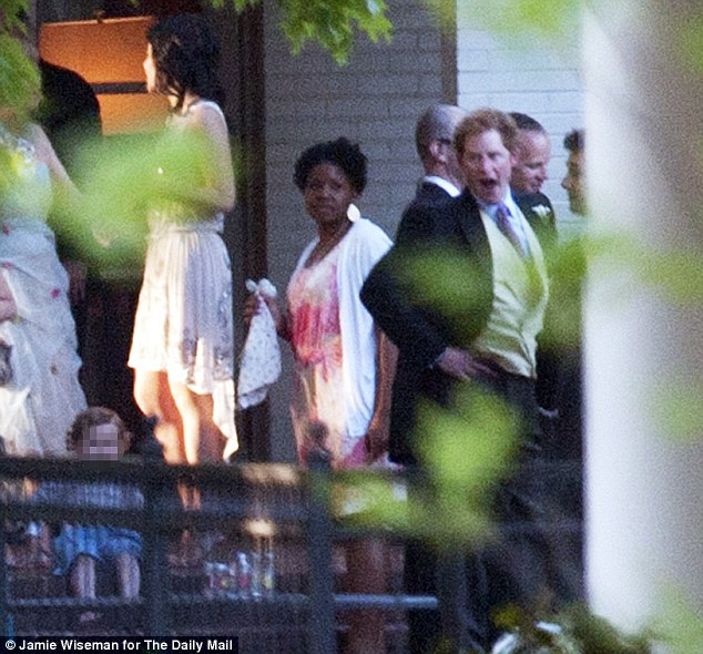 Wedding fatigue: Prince Harry takes a moment to himself following the marriage ceremony