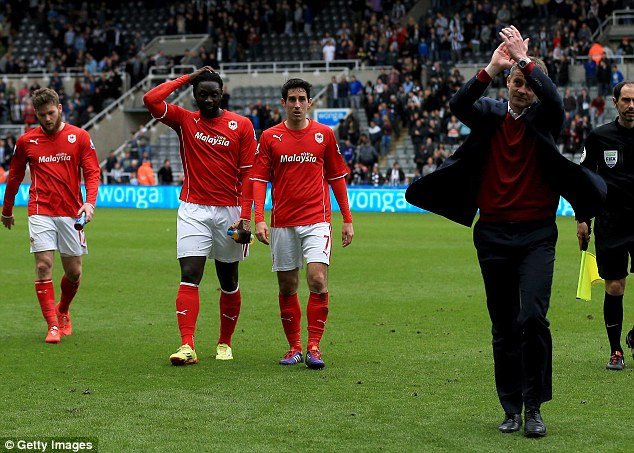 Dejected: Solskjaer leads his miserable Cardiff players - Gunnarsson, Jones and Whittingham - off the pitch