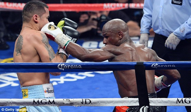Close: Floyd Mayweather (right) just managed to defeat Marcos Maidana on Saturday night