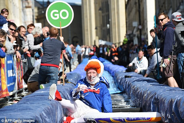 Sunny: A participant dressed in fancy dress takes part in the Bristol Park and Slide project