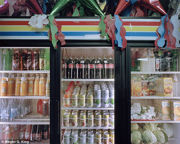 Jugo/juice: Something as simple as a grocer's beverage cooler tells a story within the confines of King's Hispanic Appalachia