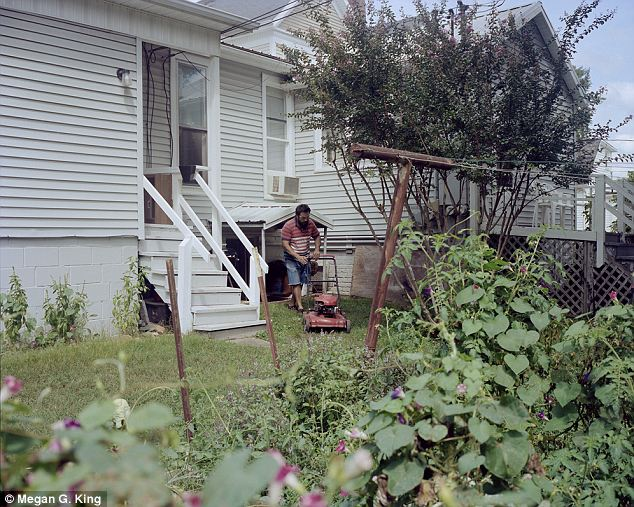 The simple vida: An Hispanic man tackles the suburban American duty of mowing the grass