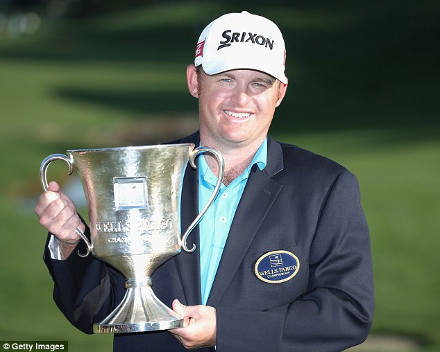 Improbable return: JB Holmes celebrated stirring victory in the Wells Fargo Championship on Sunday
