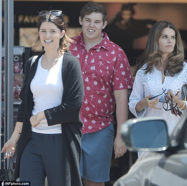 Happy family: But perhaps Maria was thinking about her credit card bill after treating her son and daughetr