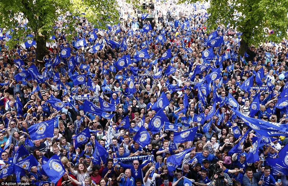 Foxes on the streets: Leicester fans lined the city in their thousands on Monday to celebrate the success of their Championship winners