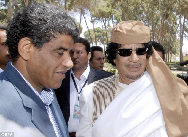 Notorious: She is representing Abdullah al-Senussi (left), Colonel Gaddafi's (right) former right-hand man