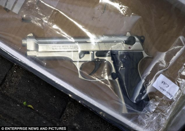 A silver and black immitation Bruni 8mm pistol used by Wheatley during his raids on banks and building societies in 2001 and 2002