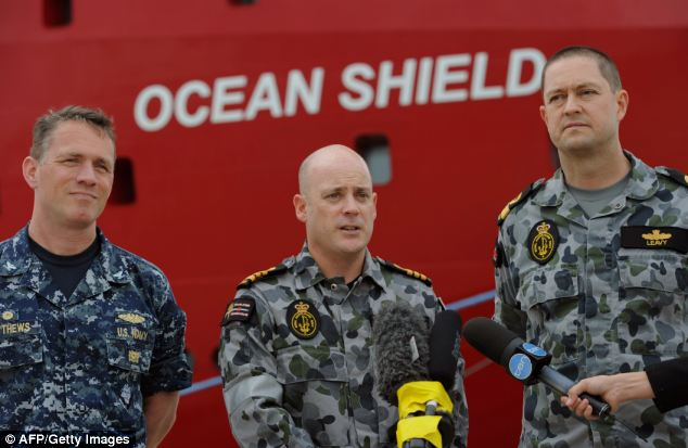 Commander Joint Task Force 658, Commodore Peter Leavy (right), United States Navy Salvage Supervisor, Captain Mark Matthews (left) and ADV Ocean Shield RAN Mission Commander, Commander James Lybrand (centre) hold a media conference in front of the Australian navy vessel Ocean Shield