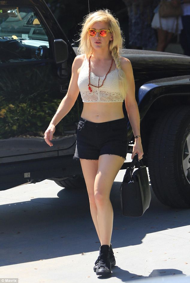 Boho look: Ellie Goulding teamed a lace crop top with prayer beads and shorts as she left her hotel to perform at Sunfest, Florida
