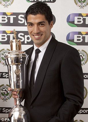 Liverpool's Luis Suarez receives the player of the year award