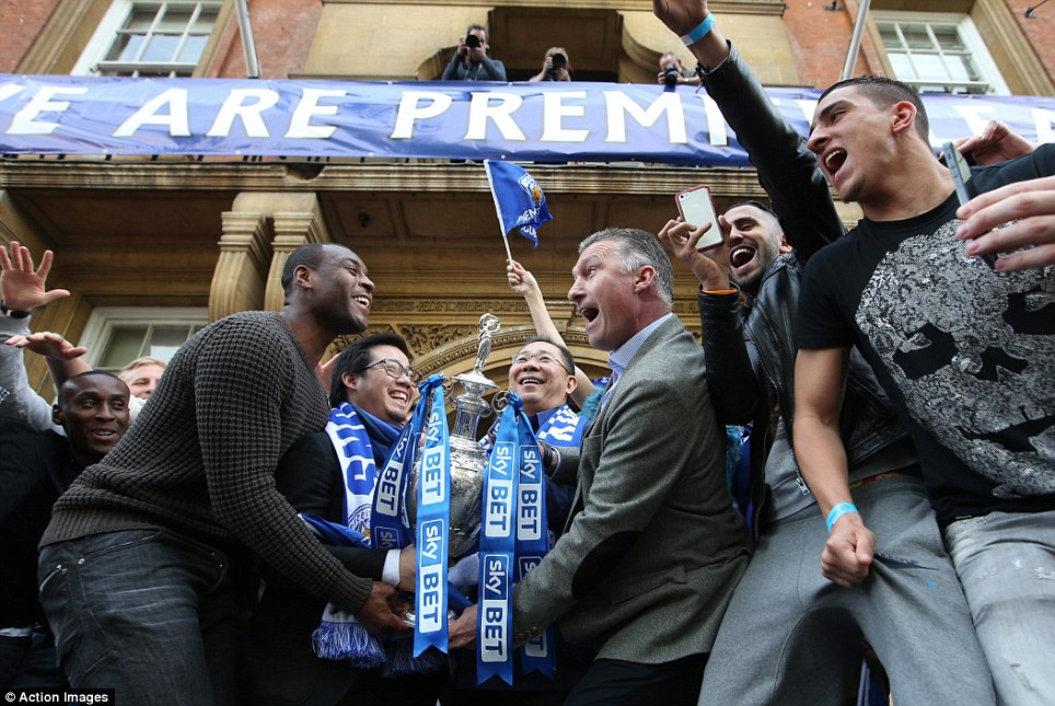 Celebration: Foxes defender and skipper Morgan and manager Nigel Pearson make a show of lifting their Championship trophy