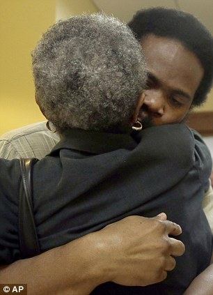 Reunion: Anderson embraces his grandmother Mary Porter after being released from custody on Monday